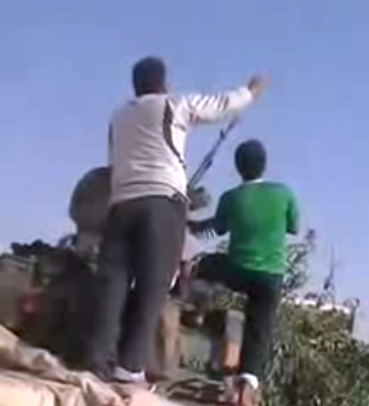 Screencap from YouTube video reportedly showing anti-regime fighters in Aleppo.