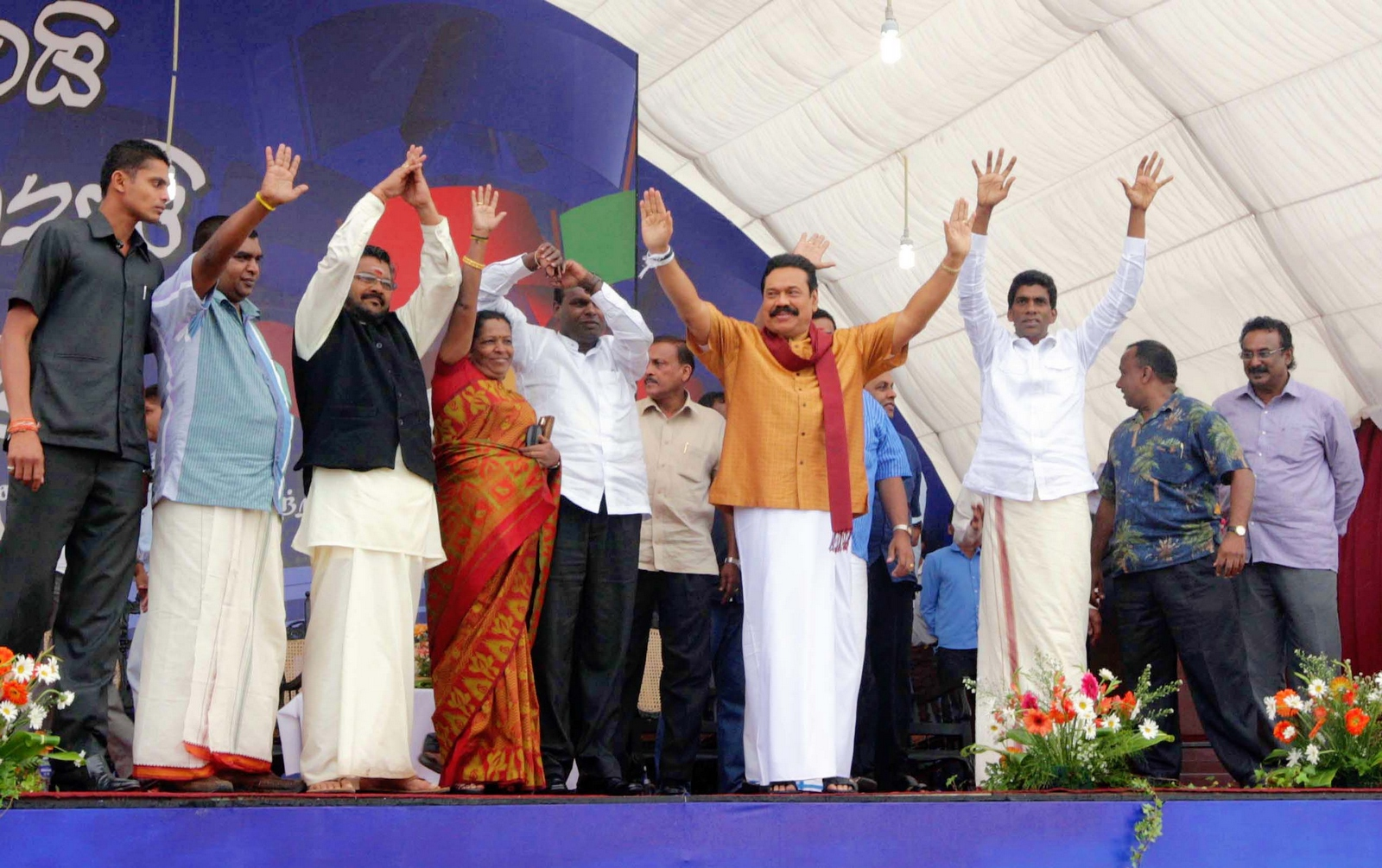 Incumbent Sri Lankan President Mahinda Rajapaksa waves to the crowd at a political rally. Via President Rajapaksa's flickr account.