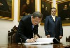 Secretary-General Ban Ki-moon signs the Mayor's guest book at the Mexico City Hall. At right is Marcelo Ebrard, Mayor of Mexico City. 8/Sep/2009. Mexico City, Mexico. UN Photo/Evan Schneider. www.unmultimedia.org/photo/