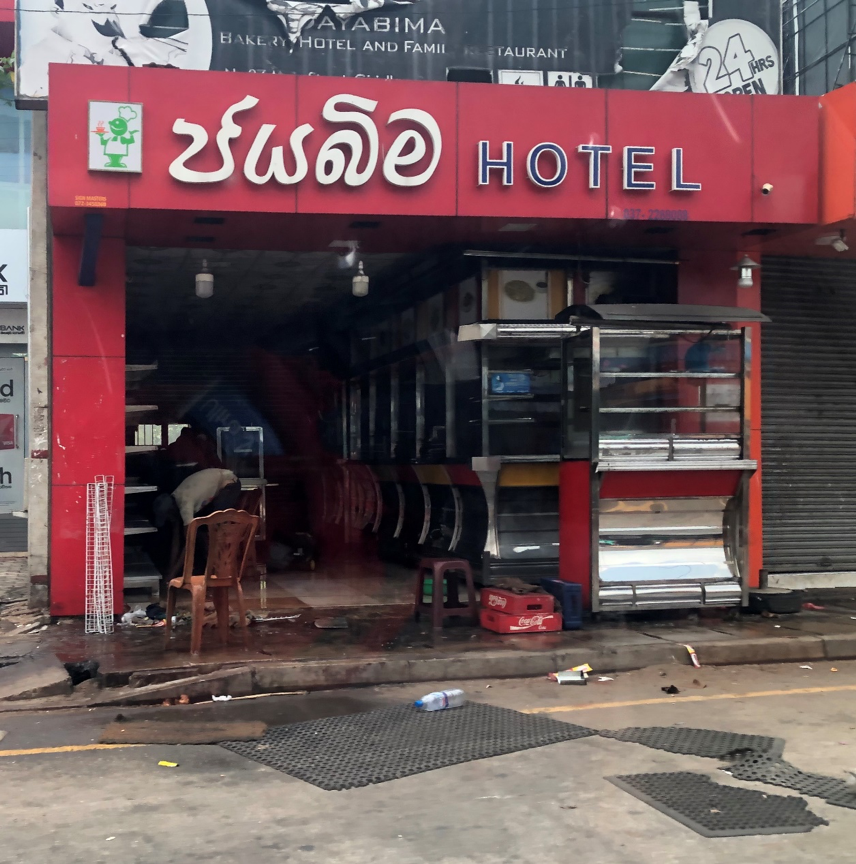Muslim proprietor cleans up after reprisal attacks May 14, 2019. Credit: Page Fortna