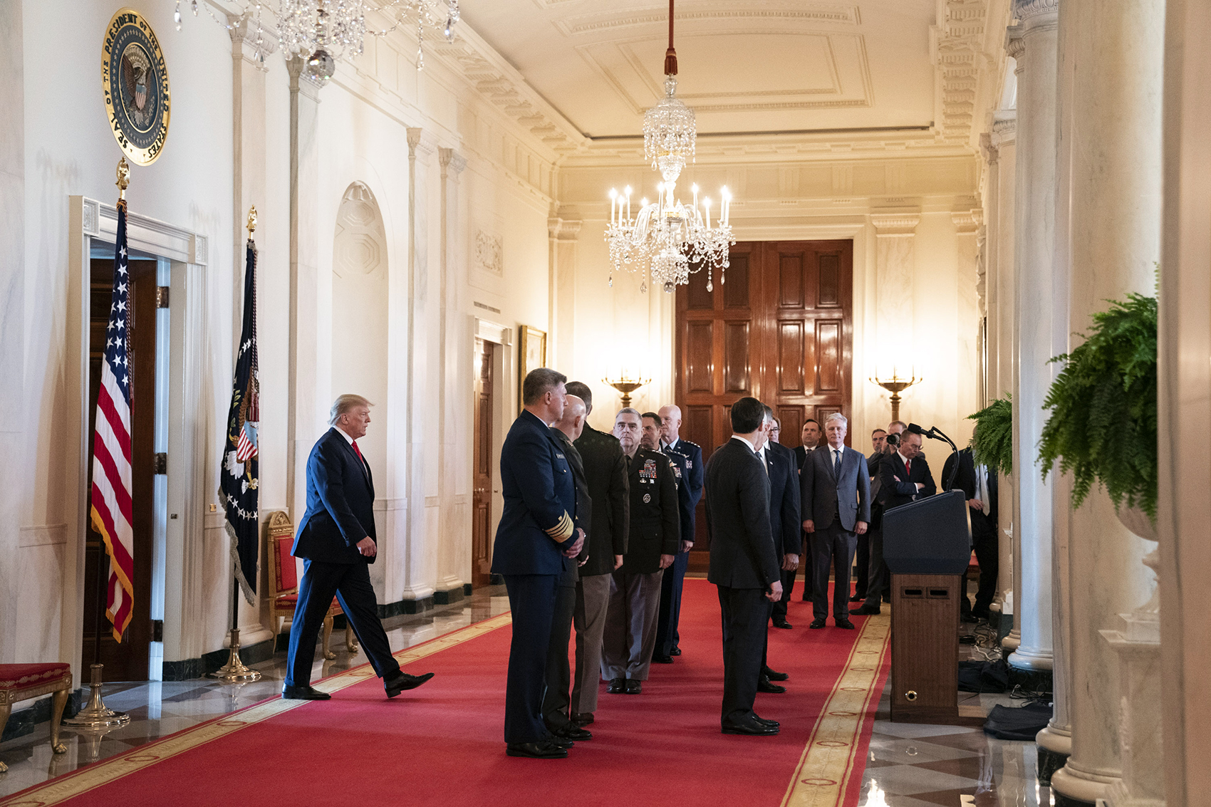 Trump preparing to address the Iranian missile strikes against US military bases in Iraq, surrounded by military personnel and White House officials. Photo courtesy of The White House.