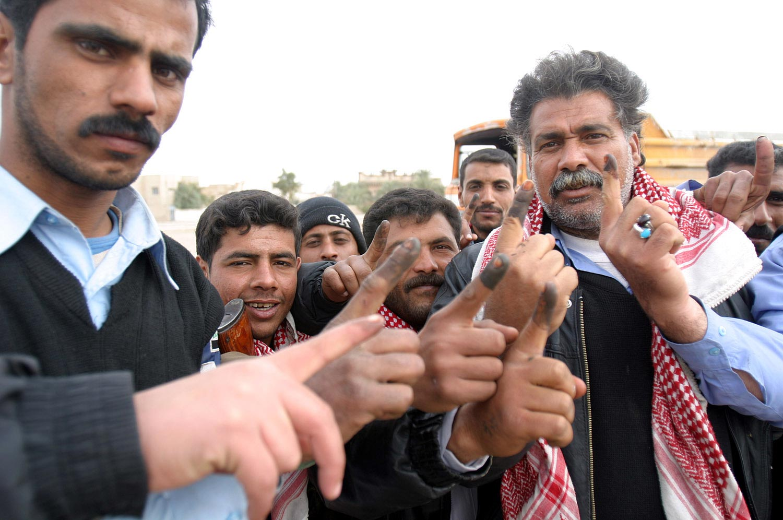 Voters in Iraq. Photo credit: United States Marine Corps.