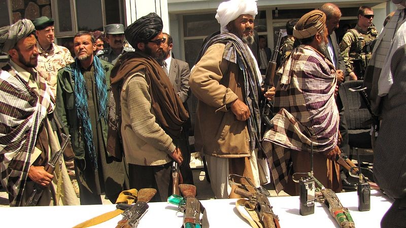 Ex-Taliban lay down their guns to the Afghan government. Photo courtesy of isafmedia.
