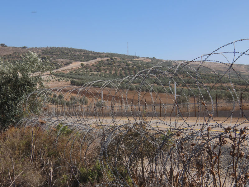Barbed wire fence separating Palestinian territory from Israel. Photo courtesy of Davidbena.