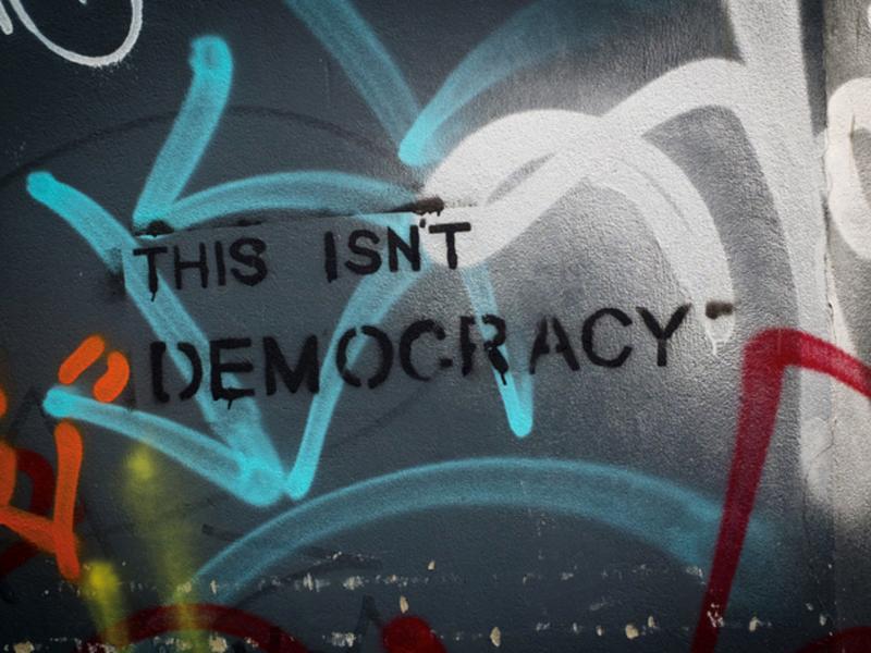 """This isn't democracy"" street art. Photo courtesy of Feral78."