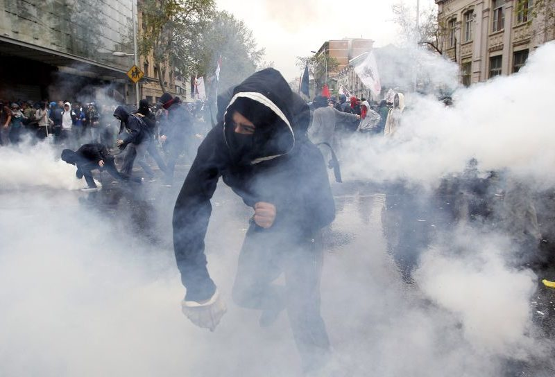 A protestor throwing a tear gas canister. Photo courtesy of C64-92.