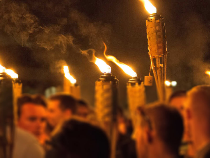 "White supremacists carry torches on the grounds of the University of Virginia, on the eve of a planned ""Unite the Right"" rally in Charlottesville, Virginia, Aug. 11, 2017. Photo courtesy of VOA via Reuters."